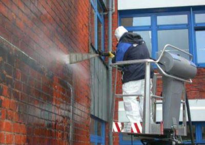 Cleaning fire damage from a redbrick wall with the PowerMaster