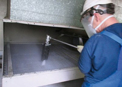 Removing lime scale from heat exchangers in a hospital